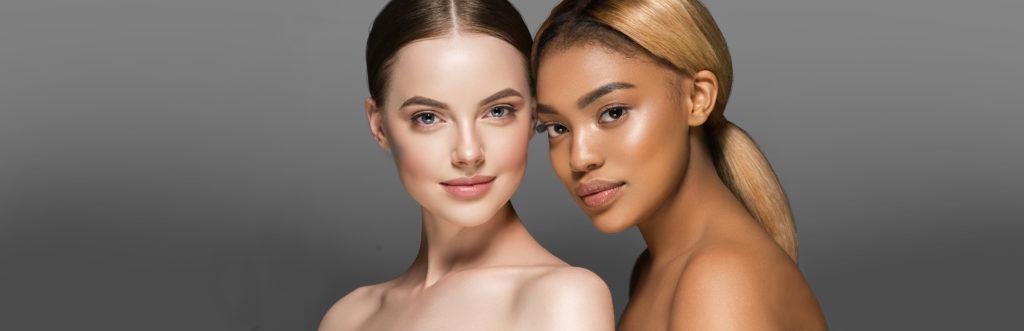 Zwei Frauen mit unterschiedlichen Hautfarben und unterschiedlichen Mikrobiomen